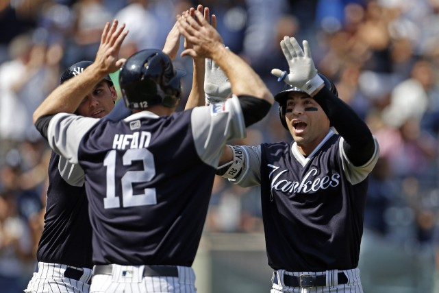 Jacoby Ellsbury, Chase Headley (12) et Greg Bird.... (Photo Adam Hunger, AP)