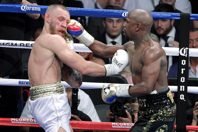 Le combat entre Conor McGregor et Floyd Mayweather... (Photo archives AFP)