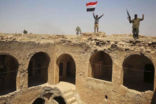 Des combattants du Hachd al-Chaabi,ces unités dites de... (AFP, Ahmad Al-Rubaye)