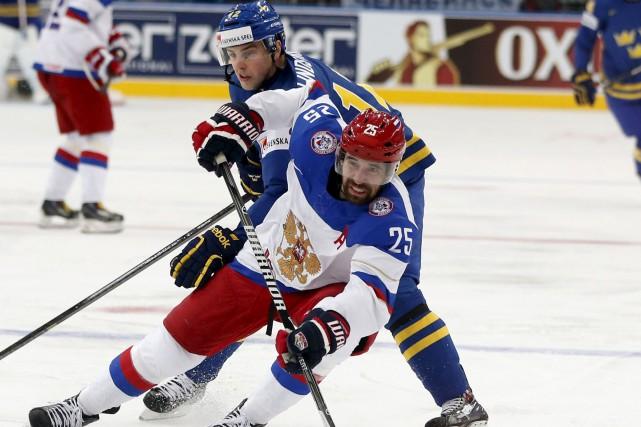 Danis Zaripov a remporté la Coupe Gagarine (KHL)... (AP, Darko Bandic)