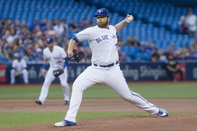 Le lanceur Brett Anderson a permis un point... (La Presse Canadienne)