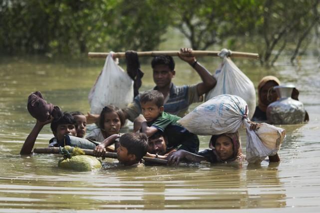 «À cause des arrivées massives de réfugiés, une... (AP)