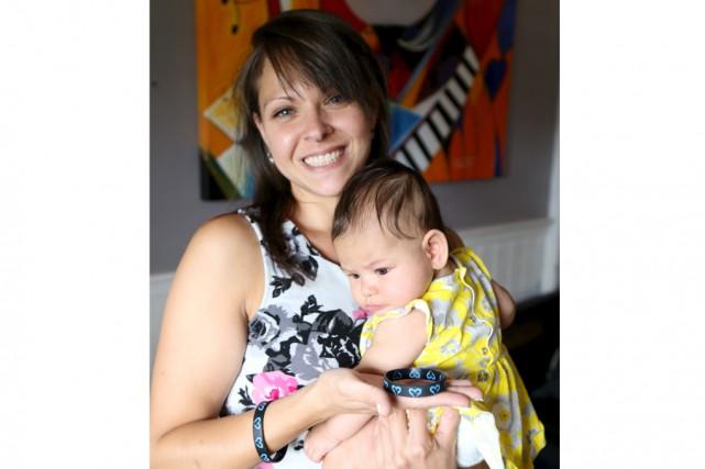 Karine Rivard, accompagnée ici de sa fille Lea,... (Janick Marois)