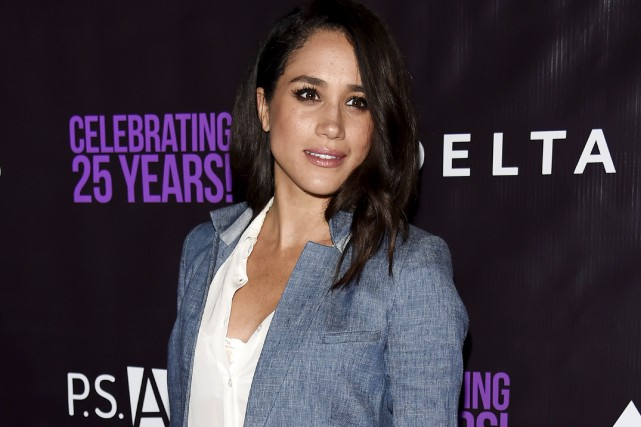 L'actrice Meghan Markle dit avoir rencontré le prince Harry en... (AP, Chris Pizzello)