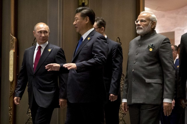 C'est de la Chine où il prenait part... (AP, Mark Schiefelbein)