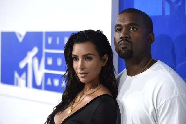 Kim Kardashian et Kanye West... (PHOTO ARCHIVES INVISION/AP)