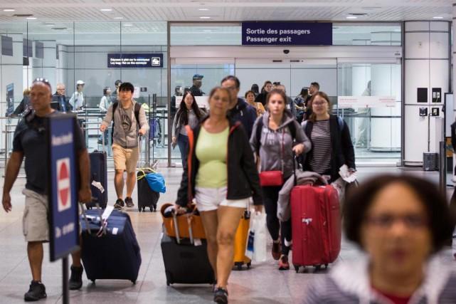 Des dizaines de Québécois qui étaient en vacances... (PHOTO SIMON GIROUX, LA PRESSE)