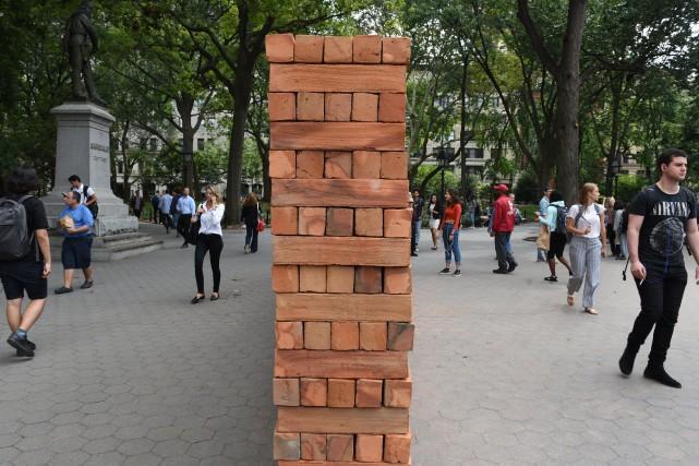 Le mur a été installé dans un parcau... (PHOTO AFP)