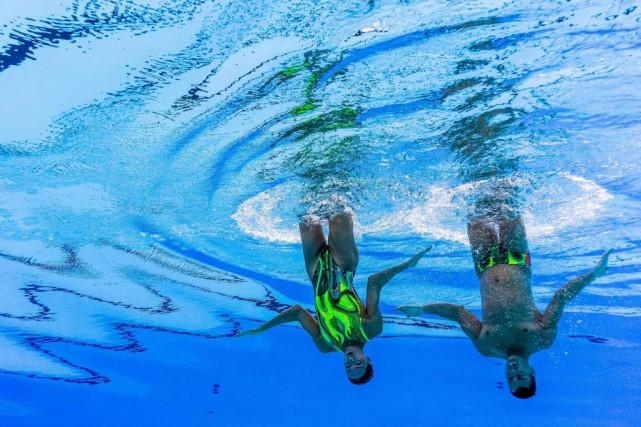 Les athlètes du Canada Isabelle Rampling et René... (PHOTO AGENCE FRANCE-PRESSE)