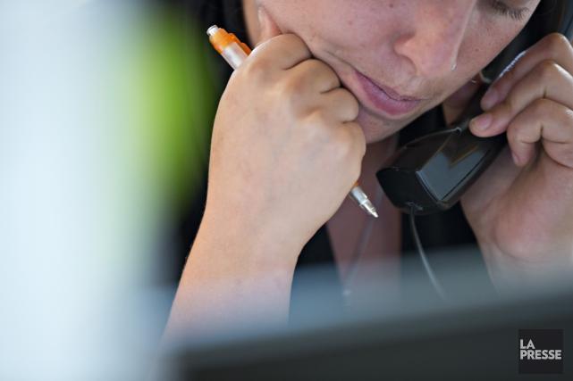 Aide téléphonique... (Archives La Presse)
