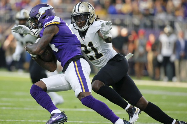 Le receveur des Vikings Stefon Diggs a capté... (Photo AP)
