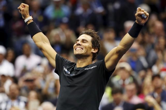 Avec son couronnement new-yorkais, dimanche, Rafael Nadal a... (AP, Julio Cortez)