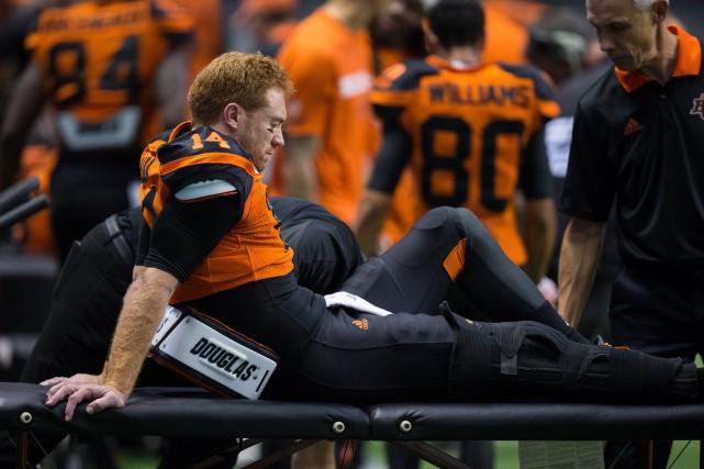 Travis Lulays'est blessé au genou droit durant le... (Photo Darryl Dyck, PC)