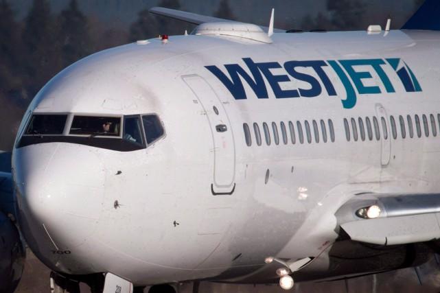 Les avions de WestJet ont accueilli plus de voyageurs que jamais pendant le... (PHOTO Darryl Dyck, ARCHIVES LA PRESSE CANADIENNE)