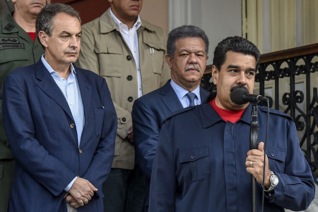 Le président vénézuélien Nicolas Maduro aux côtés del'ex-chef... (PHOTO AFP)