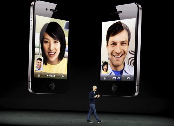 La compagnie Apple lançait son tout nouveau iPhone.... (Associated Press)