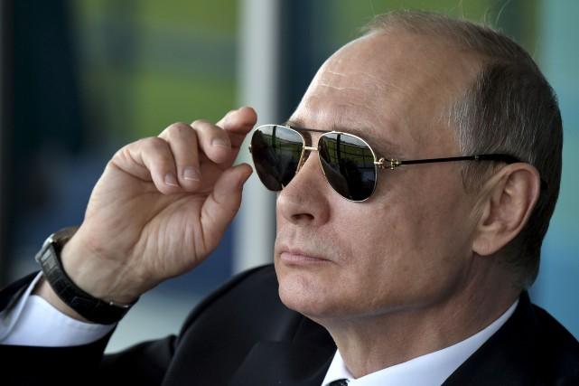 Aux dernières nouvelles, le président russe Vladimir Poutine... (Archives AP, Alexei Nikolsky)