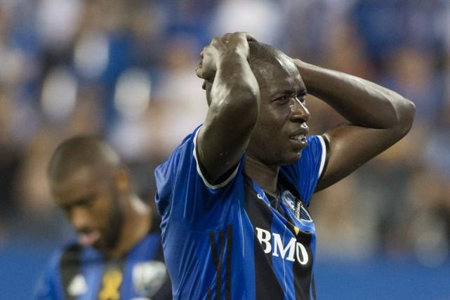 Hassoun Camara se prend la tête à deux... (La Presse canadienne, Graham Hughes)