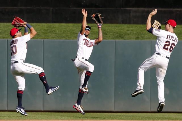Eddie Rosario, left, Byron Buxton et Max Kepler.... (Photo AP)