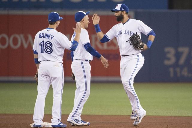 Alors que leurs espoirs sont terminés, les joueurs des Blue Jays de Toronto... (PHOTO REUTERS)