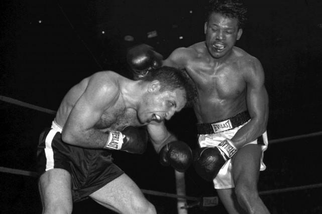 Jake LaMotta (à gauche) a affronté Sugar Ray... (archives Associated Press)