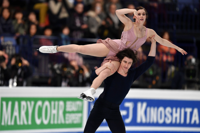 Tessa Virtue et Scott Moir... (PHOTO DANIEL MIHAILESCU, archives AGENCE FRANCE-PRESSE)