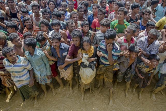 Mardi, la dirigeante birmane Aung San Suu Kyi... (PHOTO Dar Yasin, AP)