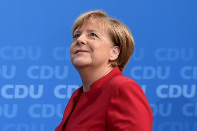 La chancelière allemande a confirmé samedi que des discussions allaient être... (PHOTO ARCHIVES AFP)