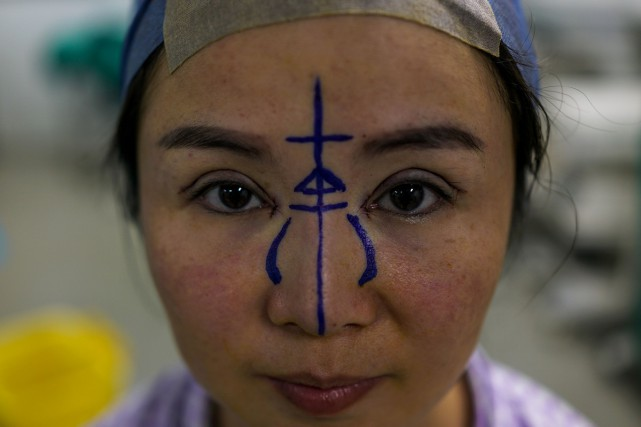 Elle n'a que 35 ans mais est assaillie... (PHOTO AFP)