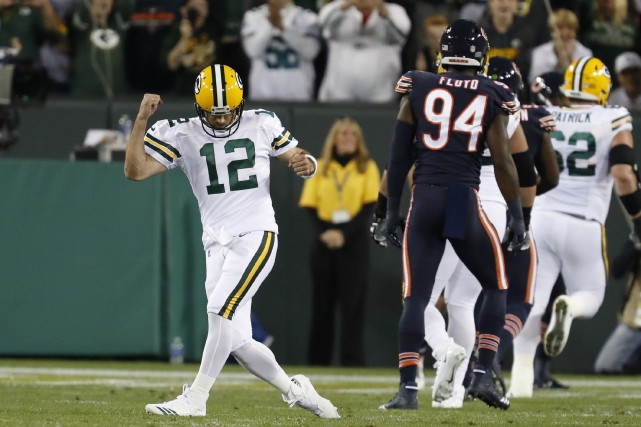 Le quart des Packers Aaron Rodgers (12) célèbre... (Photo Matt Ludtke, AP)