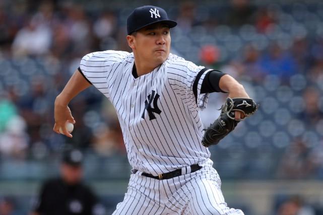 Le lanceur des Yankees Masahiro Tanaka a retiré... (Photo Brad Penner, USA Today Sports)