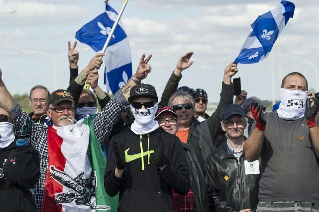 Les membres de Storm Alliance, certains portant un... (PHOTO PC)