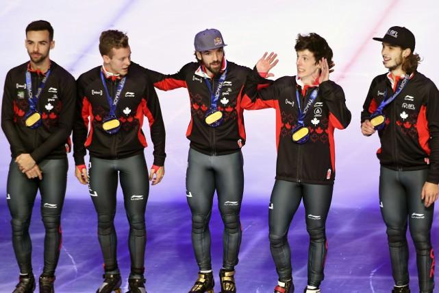 Le relais canadien masculin a remporté la médaille... (Photo Attila Kisbenedek, Agence France-Presse)