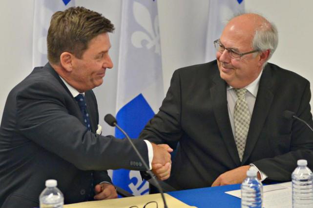Pierre Moreau,président du Conseil du trésor, etLouis Godin,... (Photo Pascal Ratthé, Le Soleil)