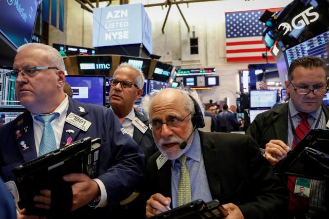 Selon les résultats définitifs, l'indice vedette Dow Jones... (REUTERS)