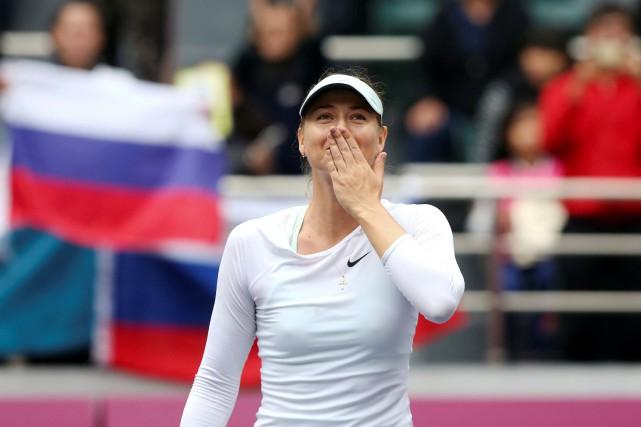 La réaction de Maria Sharapova à l'annonce de... (Photo REUTERS)