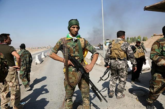 Lundi, à l'arrivée des forces irakiennes dans la... (PHOTO AP)