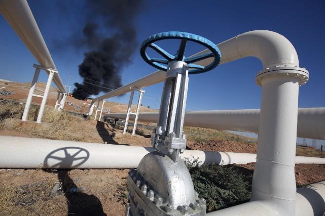 Cinq des six champs pétroliers de la province... (PHOTO AFP)