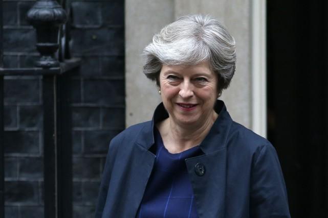 La cheffe du gouvernement conservateur, Theresa May, participe... (AFP)