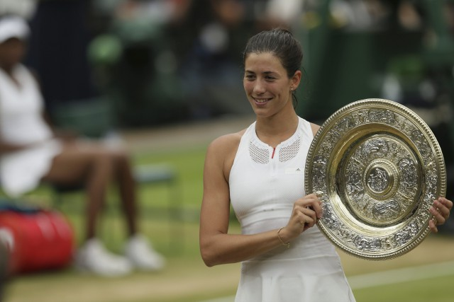 Garbine Muguruza a remporté le tournoi de Wimbledon... (Photo Tim Ireland, AP)