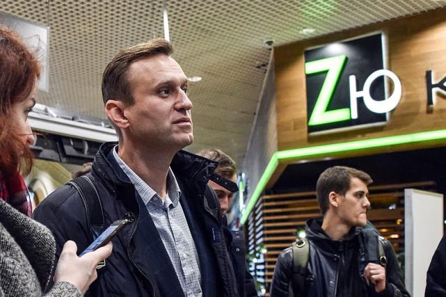 Alexei Navalny à l'aéroport international Domodedovo après sa... (PHOTO VASILY MAXIMOV, AGENCE FRANCE-PRESSE)