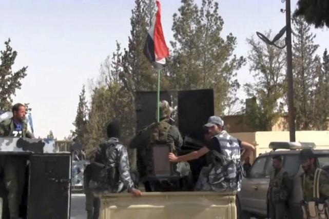 Les civils auraient été exécutés par des djihadistes... (AP)