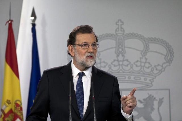 Le gouvernement espagnol, dirigé par Mariano Rajoy (sur... (Photo Paul White, AP)