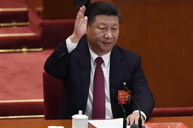 Le leader de 64 ans Xi Jinping, à... (AFP)