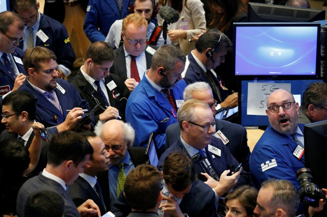 Le Dow Jones prenait 0,58% et le Nasdaq... (REUTERS)