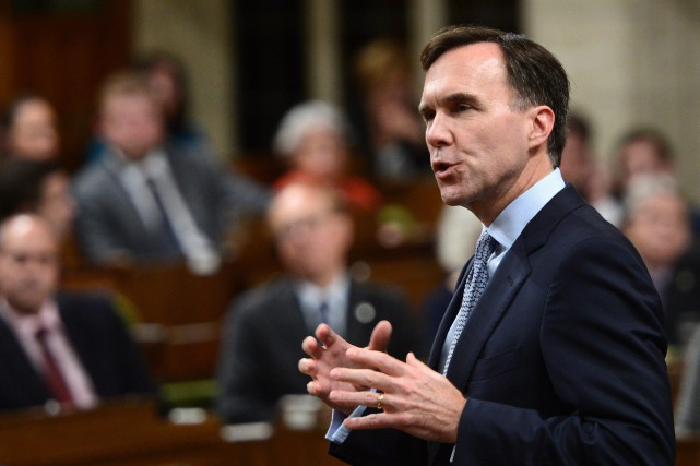 Minister of Finance Bill Morneau stands during question... (THE CANADIAN PRESS)