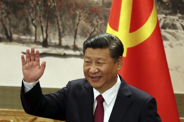 Conformément à la tradition, Xi Jinping, costume sombre... (Photo archives Associated Press)