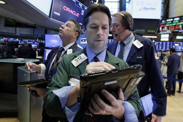 En pleine saison des comptes trimestriels, les investisseurs... (AP)