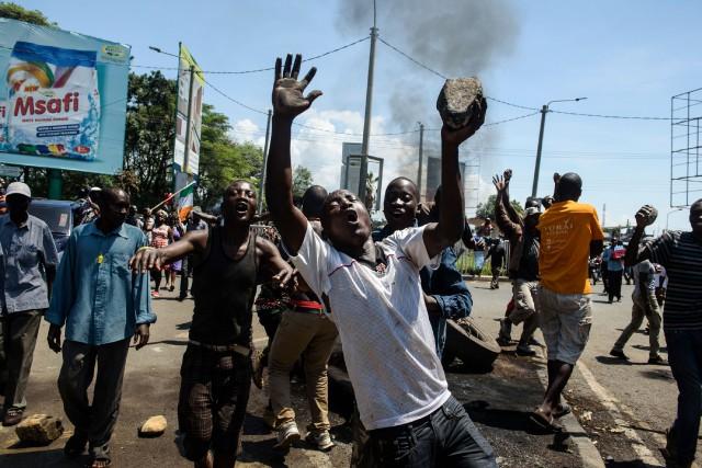 Dix ans après les pires violences post-électorales de... (AFP)