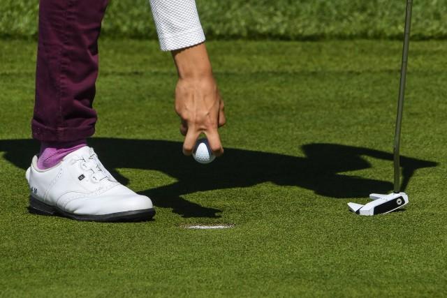 Il y a une chance sur 17 millions que deux golfeurs amateurs réussissent, coup... (PHOTO ARCHIVES AFP)